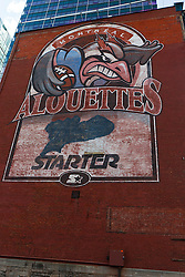 Logo for the Montreal Alouettes football team painted on the side of a brick building, downtown, Montreal, Quebec, Canada