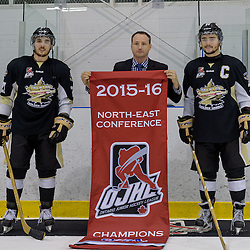 KINGSTON, - Apr 6, 2016 -  Ontario Junior Hockey League game action between Trenton Golden Hawks and Kingston Voyageurs. Game 4 of the North East Championship series.  at the Invista Centre, ON. Marty Savoy League Commissioner presents the OJHL NEC Championship banner to Danny Hanlon and Adam Clements. (Photo by Ian Dixon / OJHL Images)