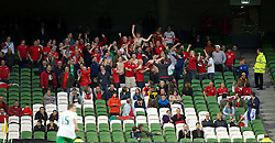 DUBLIN, REPUBLIC OF IRELAND - Friday, May 27, 2011: Wales' supporters celebrate a 2-0 victory over Northern Ireland during the Carling Nations Cup match at the Aviva Stadium (Lansdowne Road). (Photo by David Rawcliffe/Propaganda)