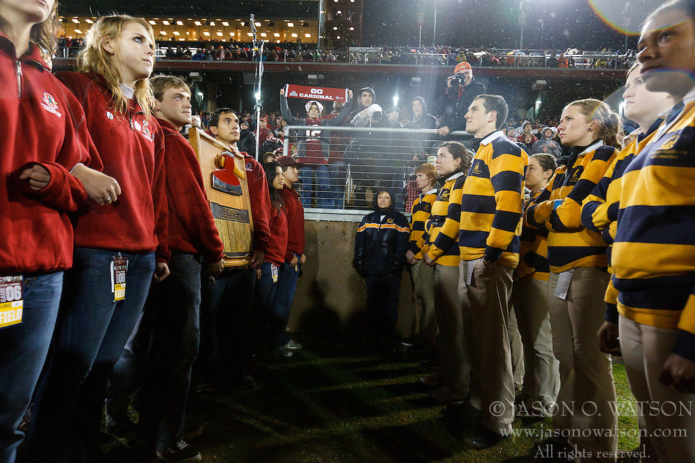 Nov 19, 2011; Stanford CA, USA;  Stanford Cardinal students (left) hold the Stanford axe in front of California Golden Bears students (right) during the fourth quarter at Stanford Stadium.  Stanford defeated California 31-28. Mandatory Credit: Jason O. Watson-US PRESSWIRE