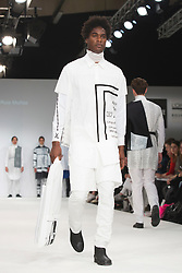 © Licensed to London News Pictures. 02/06/2015. London, UK. Collection by Paulo Jair Ruiz Munoz of Lisaa Mode Paris. Samsonite International Catwalk Competition takes place during Graduate Fashion Week 2015. Graduate Fashion Week takes place from 30 May to 2 June 2015 at the Old Truman Brewery, Brick Lane. Photo credit : Bettina Strenske/LNP