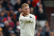 Ben Stokes of England holds his injured shoulder during the International Test Match 2019, fourth test, day two match between England and Australia at Old Trafford, Manchester, England on 5 September 2019.