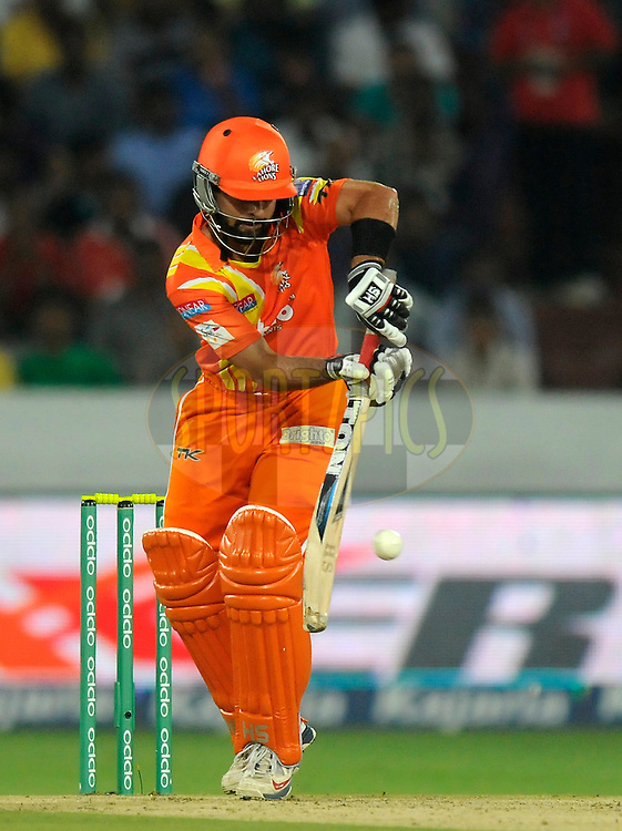 Ahmed Shehzad of Lahore Lions bats during match 7 of the Oppo Champions League Twenty20 between the Kolkata Knight Riders and the Lahore Lions held at the Rajiv Gandhi Cricket Stadium, Hyderabad, India on the 21st September 2014<br /> <br /> Photo by:  Pal Pillai / Sportzpics/ CLT20<br /> <br /> <br /> Image use is subject to the terms and conditions as laid out by the BCCI/ CLT20.  The terms and conditions can be downloaded here:<br /> <br /> http://sportzpics.photoshelter.com/gallery/CLT20-Image-Terms-and-Conditions-2014/G0000IfNJn535VPU/C0000QhhKadWcjYs