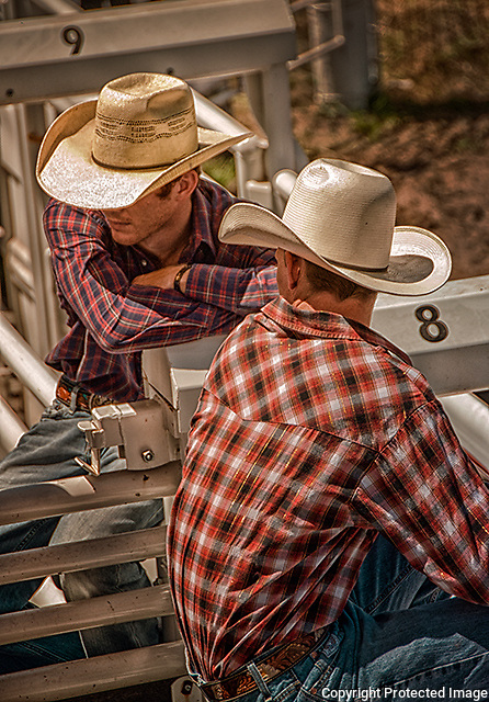 Rodeo Cowboys Pre-Ride discussion. Photo by premier Nebraska Sports Photographer Barry A Mosley.