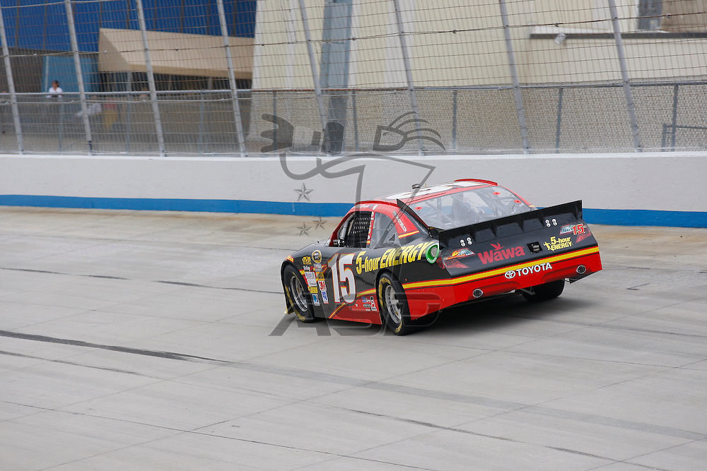 DOVER, DE - JUN 01, 2012:  Clint Bowyer (15) brings his 5-hour ENERGY Toyota on the track for a practice session for the FedEx 400 Benefiting Autism Speaks at the Dover International Speedway in Dover, DE.