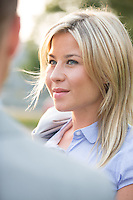 Smiling businesswoman looking at businessman outdoors