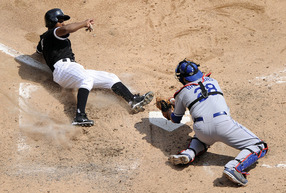CHICAGO - MAY 22:  Juan Pierre #1 of the Chicago White Sox slides home safely on a sacrifice fly by Paul Konerko #14 as Rod Barajas #28 of the Los Angeles Dodgers makes a late tag in the fourth inning on May 22, 2011 at U.S. Cellular Field in Chicago, Illinois.  The White Sox defeated the Dodgers 8-3.  (Photo by Ron Vesely)  Subject: