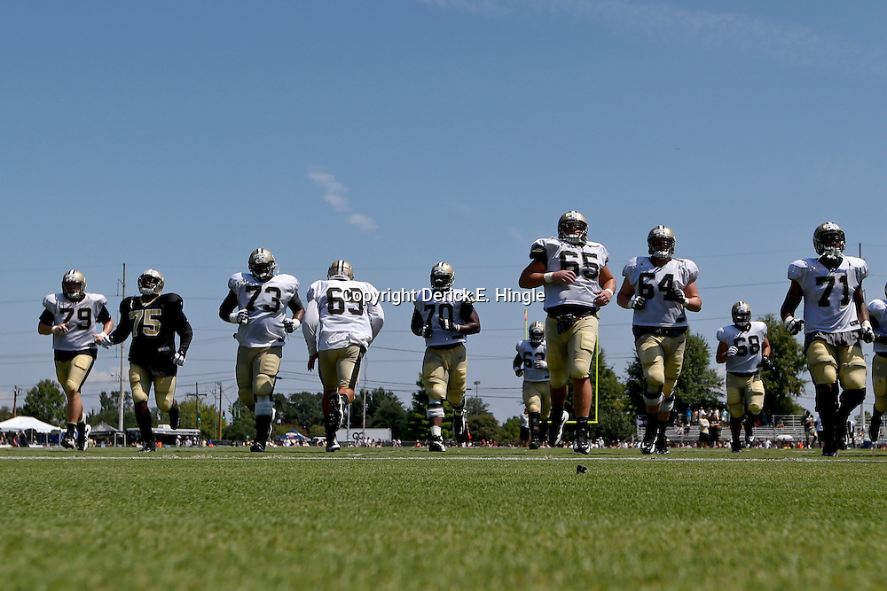 Jul 29, 2013; Metairie, LA, USA; New Orleans Saints players run sprints at the end of a morning training camp practice at the team facility.  Mandatory Credit: Derick E. Hingle-USA TODAY Sports