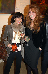 Left to right, PILAR BOXFORD and CHARLOTTE TILBURY at an exhibition of recent work by artist Lance Tilbury held at the Old Imperial Laundry, Warriner Gardens, Battersea, London on 7th December 2004.<br />