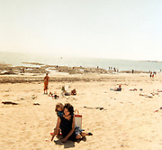 mother with child happy moment at the beach ca 1980s