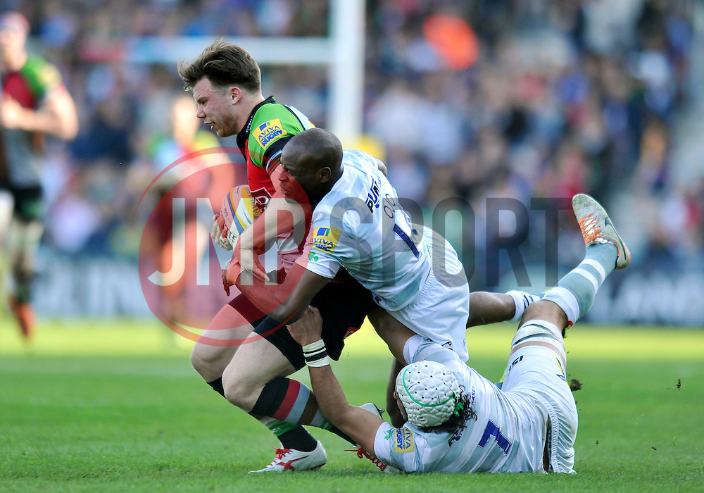 Sam Smith (Harlequins) is tackled by Topsy Ojo (London Irish) - Photo mandatory by-line: Patrick Khachfe/JMP - Tel: Mobile: 07966 386802 29/03/2014 - SPORT - RUGBY UNION - The Twickenham Stoop, London - Harlequins v London Irish - Aviva Premiership.