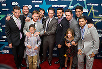 The cast of HBO's Entourage poses with the show's executives on the red carpet at the premiere of the show's 8th and final season.