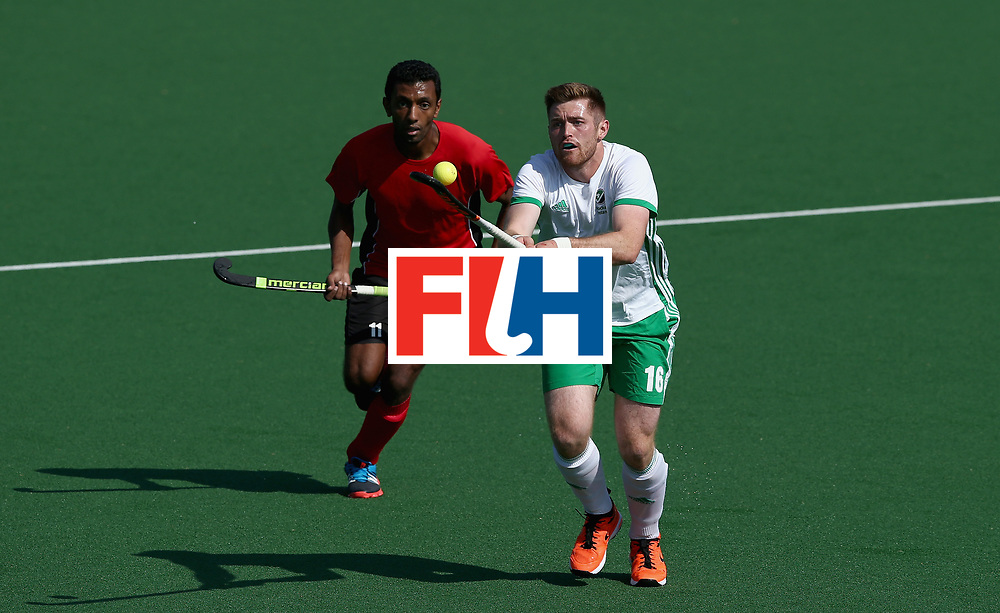JOHANNESBURG, SOUTH AFRICA - JULY 13: Shane O'Donoghue of Ireland controls the ball under pressure from Ahmed Elnaggar of Egypt  during day 3 of the FIH Hockey World League Semi Finals Pool B match between Ireland and Egypt at Wits University on July 13, 2017 in Johannesburg, South Africa. (Photo by Jan Kruger/Getty Images for FIH)