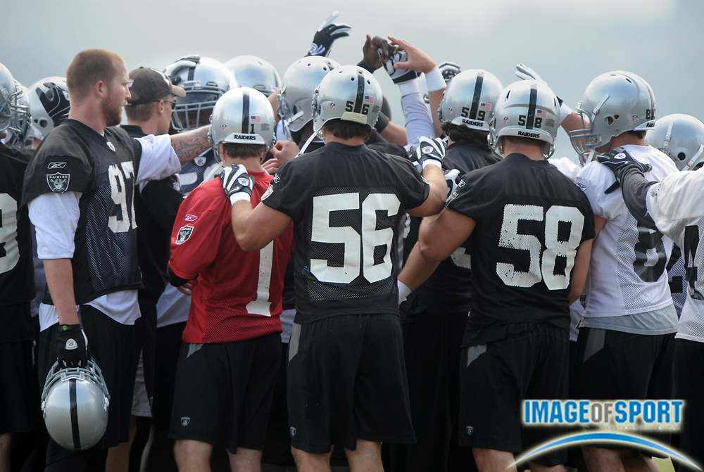 May 26, 2010; Alameda, CA, USA; Oakland Raiders players huddle at organized team activities at the Oakland Raiders practice facility.