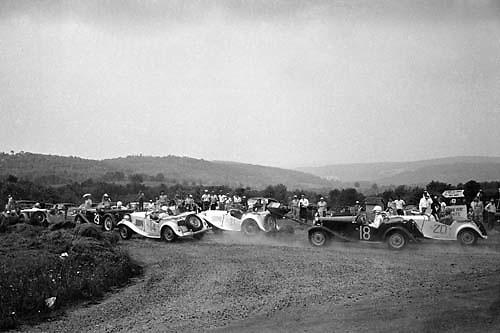 A pack of MGs scramble around the first turn in the sports car race at Callicoon, NY, 1953.