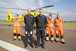 July 27, 2017 - Cambridge, United Kingdom - Image licensed to i-Images Picture Agency. 27/07/2017. Cambridge, United Kingdom. Prince William poses for a group photograph with his crew as he starts his last shift with  the East Anglia Air Rescue at Cambridge airport, United Kingdom. Picture by ROTA / i-Images UK OUT FOR 28 DAYS (Credit Image: © Rota/i-Images via ZUMA Press)
