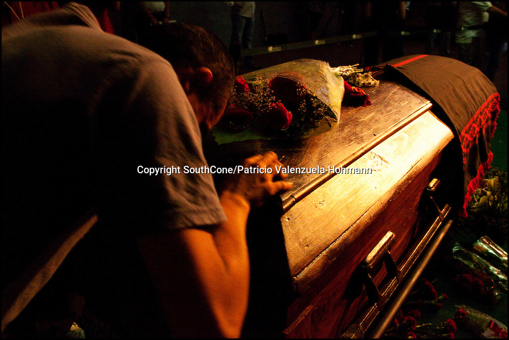 A man lies on Victor Jara`s coffin.<br /> After 36 years, Chile's most popular folk singer, Victor Jara was mourned and buried. About 10.000 people attended to his vigil and funeral. Victor Jara was assassinated on September 15 1973 by Pinochet`s military officials of at least 43 gunshots and massive beatings. His 1973 funeral had to be made in private because of military restrictions.