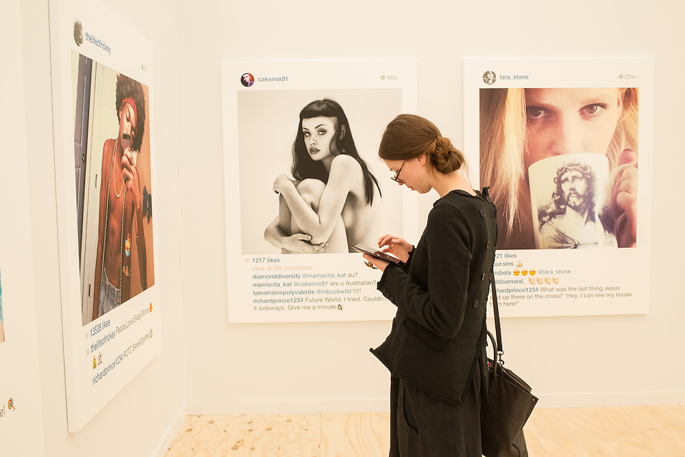 A woman makes a note on her tablet in the Gagosian Gallery, which showed here a group of enlargements of Instagram photographs. Prince is being sued for copyright infringement as a result.