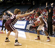 The Flyers Kathy Guin (23) looks for an opening, the Fordham Rams Annie Zopf (35) guards and Rams head coach Cathy Andruzzi (right) sends signals to the team from the sidelines during a UD Women's basketball game at the University of Dayton Arena, January 21, 2007.