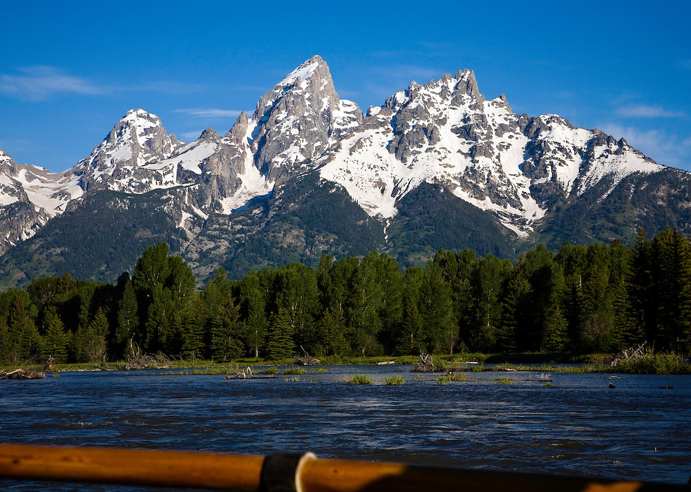Teton National Park, WY:  Early morning float on the Snake River through the heart of the park.  Mount Moran, with oar handle in foreground.