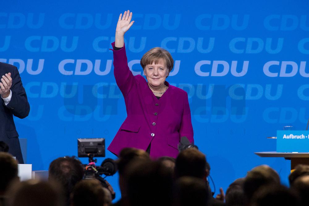26 FEB 2018, BERLIN/GERMANY:<br /> Angela Merkel, CDU, Bundeskanzlerin, nimmt nach ihrer Rede den Applaus der Delegierten entgegen, CDU Bundesparteitag, Station Berlin<br /> IMAGE: 20180226-01-085<br /> KEYWORDS: Party Congress, Parteitag