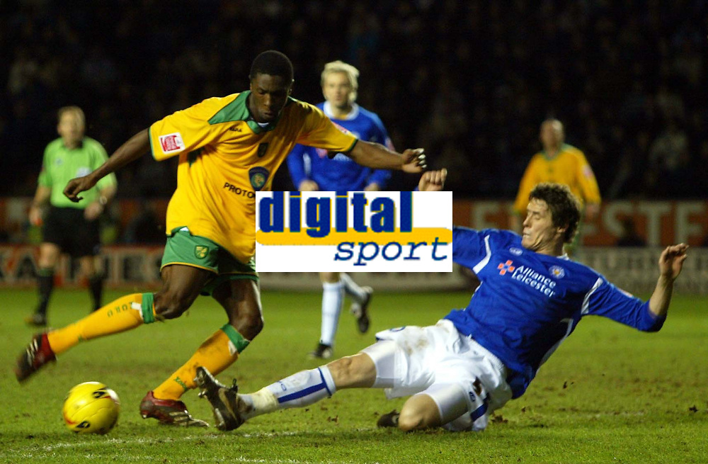 Photo: Chris Ratcliffe.<br />Leicester City v Norwich City. Coca Cola Championship. 31/12/2005.<br />Dickson Etuhu (L) of Norwich gets a shot away as Patrick McCarthy slides in.