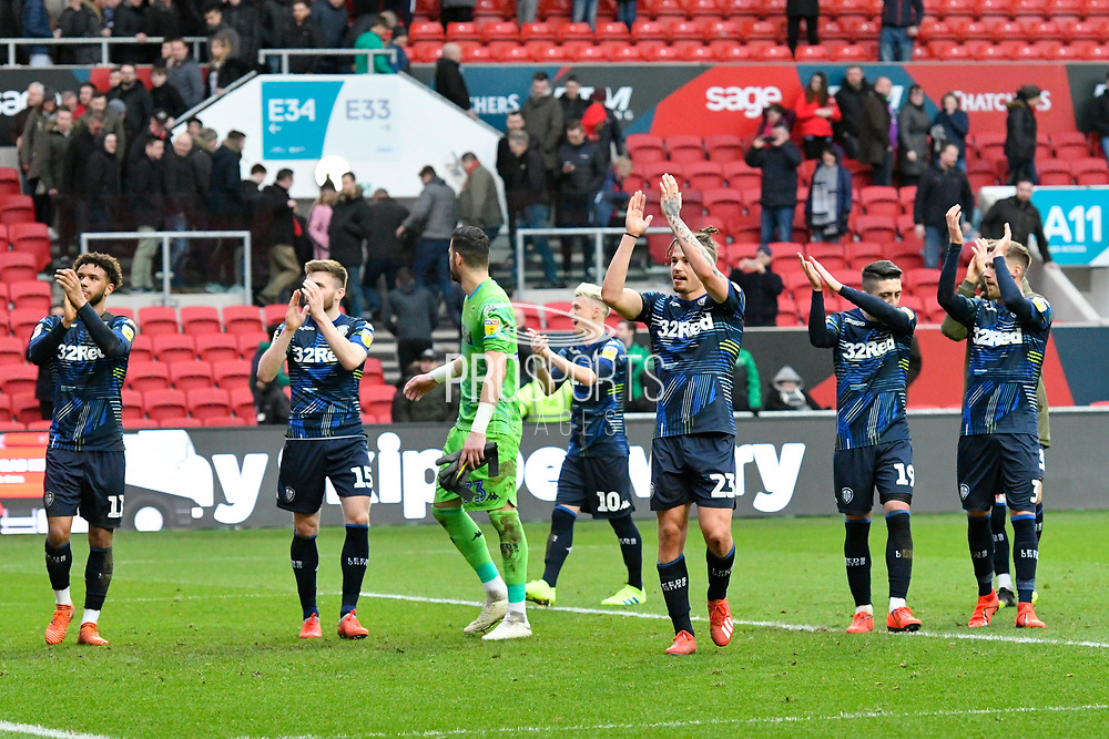Leeds United players celebrate the 1-0 win over Bristol City at full time during the EFL Sky Bet Championship match between Bristol City and Leeds United at Ashton Gate, Bristol, England on 9 March 2019.