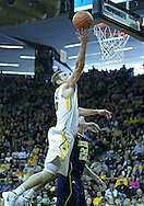 January 14, 2011: Iowa Hawkeyes guard/forward Eric May (25) puts up a shot as Michigan Wolverines forward Blake McLimans (22) looks on during the NCAA basketball game between the Michigan Wolverines and the Iowa Hawkeyes at Carver-Hawkeye Arena in Iowa City, Iowa on Saturday, January 14, 2011. Iowa defeated Michigan 75-59.