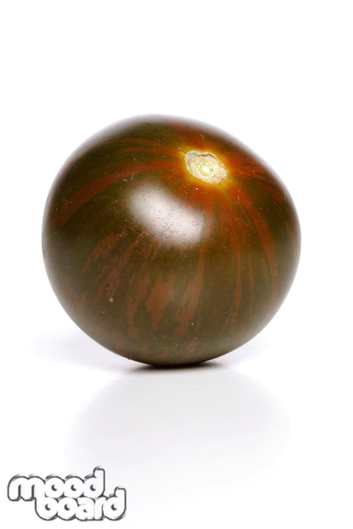 Studio shot of black tomato on white background