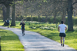 © Licensed to London News Pictures. 29/03/2020. London, UK. People jogging through Regents Park, London in the early morning sun, during a lockdown over the Coronavirus spread. Members of the public have been told they can only leave their homes to exercise briefly once a day, and to go to shops for essentials when absolutely necessary, in an attempt to fight the spread of COVID-19. Photo credit: Ben Cawthra/LNP