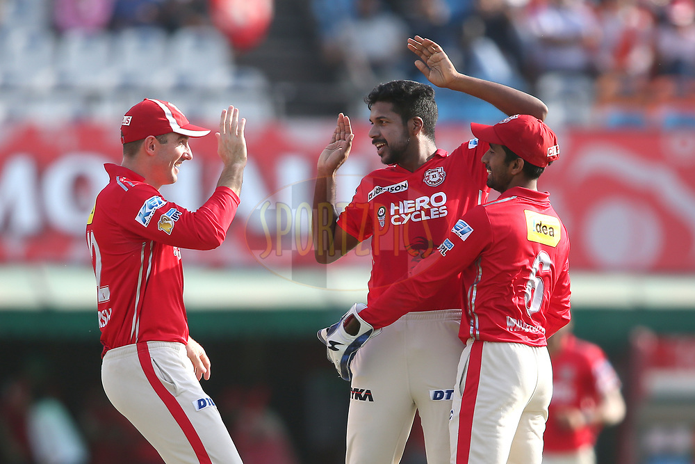 Varun Aaron of Kings XI Punjab is congratulated by Shaun Marsh of Kings XI Punjab and Wriddhiman Saha of Kings XI Punjab for bowling Corey Anderson of the Delhi Daredevils during match 36 of the Vivo 2017 Indian Premier League between the Kings XI Punjab and the Delhi Daredevils held at the Punjab Cricket Association IS Bindra Stadium in Mohali, India on the 30th April 2017<br /> <br /> Photo by Shaun Roy - Sportzpics - IPL