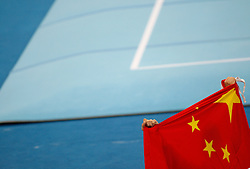 China's Zou Kai celebrates with teh country flag after winning the gold for the floor event of  artistic gymnastics apparatus finals during the Olympic games in Beijing, China, 17 August 2008.