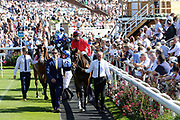 The horses start to leave the Parade Ring for the The Sky Bet Ebor Handicap over 1m 6f (£1,000,000)  during the Ebor Festival at York Racecourse, York, United Kingdom on 24 August 2019.