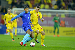 November 14, 2017 - Bucharest, Romania - Netherlands's Virgil vies Romania's George Tucudean during International Friendly match between Romania and Netherlands at National Arena Stadium in Bucharest, Romania, on 14 november 2017. (Credit Image: © Alex Nicodim/NurPhoto via ZUMA Press)