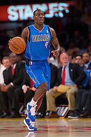 02 April 2013: Guard (4) Darren Collison of the Dallas Mavericks dribbles the ball up the court against the Los Angeles Lakers during the first half of the Lakers 101-81 victory over the Mavericks at the STAPLES Center in Los Angeles, CA.
