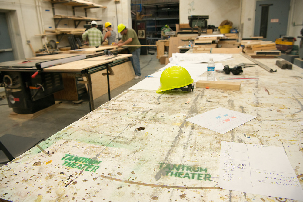 Carpenters work to contruct a set for Tantrum Theater in Kantner Hall. Photo by Ben Siegel