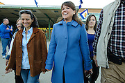 Christine O'Donnell, candidate for U.S. Senate in Delaware, center in blue, leaves after casting her vote in this mid-term election at Charter School in Wilmington, De Tuesday 2 November 2010. (Photography by Jim Graham)