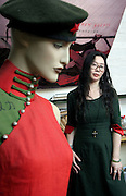 Chinese fashion designer Feng Ling poses with one of her creations in her Beijing studio.