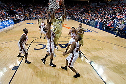 Georgia Tech forward Gani Lawal (31) shoots over Virginia forward Adrian Joseph (30).  The Virginia Cavaliers men's basketball team fell to the Georgia Tech Yellow Jackets 92-82 in overtime at the John Paul Jones Arena in Charlottesville, VA on January 27, 2008.