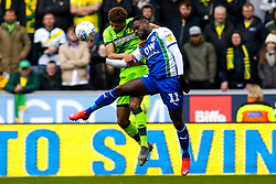 Jamal Lewis of Norwich City challenges Gavin Massey of Wigan Athletic - Mandatory by-line: Robbie Stephenson/JMP - 14/04/2019 - FOOTBALL - DW Stadium - Wigan, England - Wigan Athletic v Norwich City - Sky Bet Championship