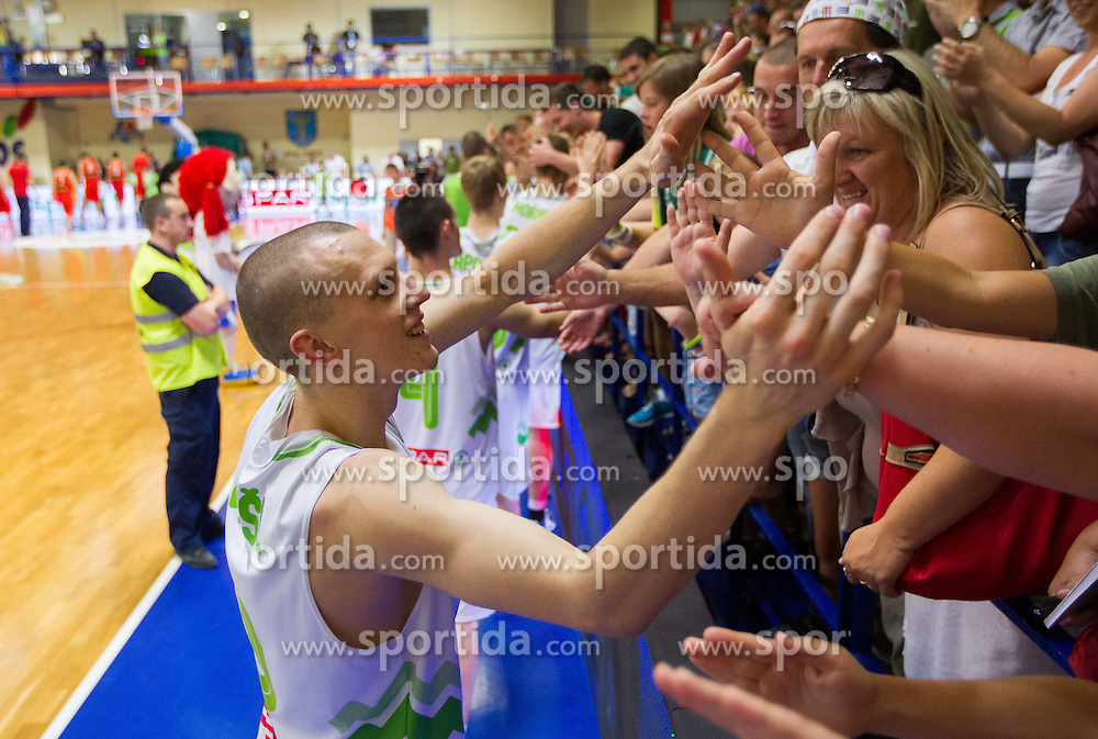 Miha Vasl of Slovenia celebrates after the basketball match between National teams of Slovenia and Spain in Qualifying Round of U20 Men European Championship Slovenia 2012, on July 18, 2012 in Domzale, Slovenia. Slovenia defeated Spain 70-63. (Photo by Vid Ponikvar / Sportida.com)