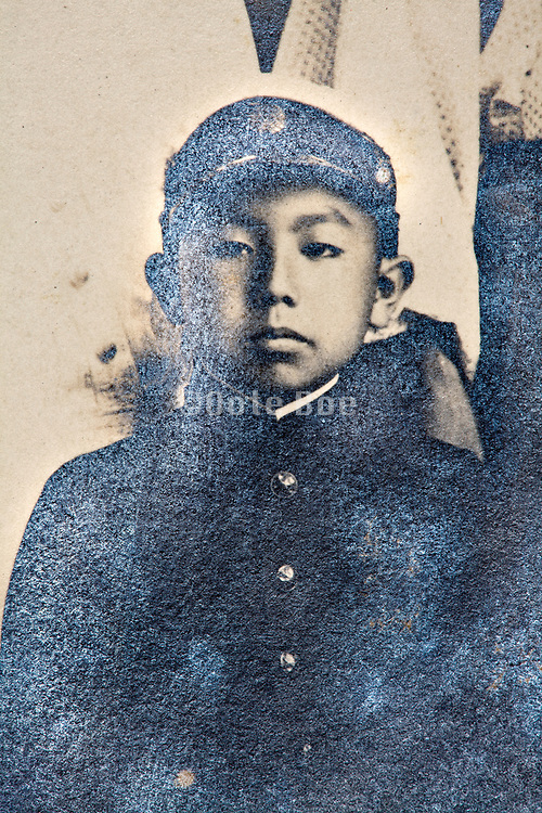 partly silver mirroring photograph portrait of a young boy in school uniform Japan