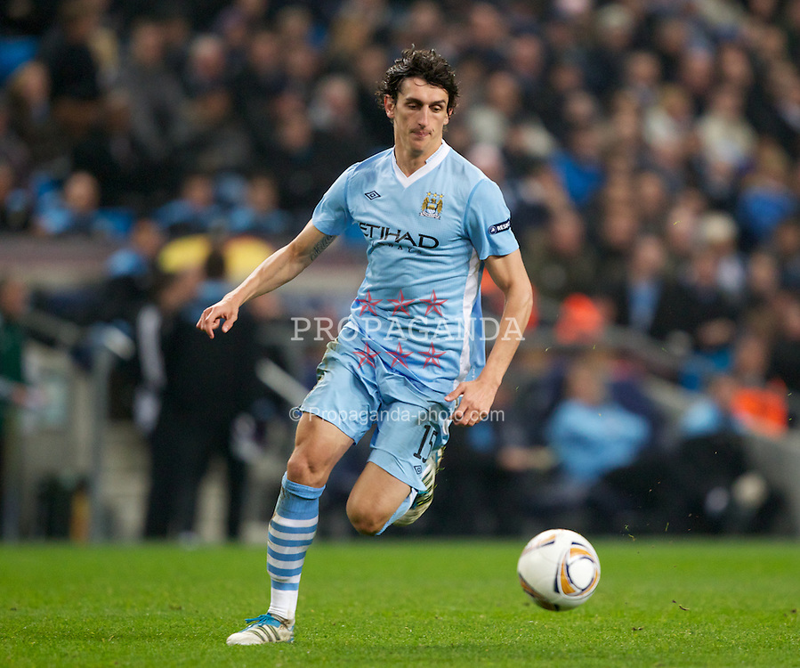 MANCHESTER, ENGLAND - Thursday, March 15, 2012: Manchester City's Stefan Savic in action against Sporting Clube de Portugal during the UEFA Europa League Round of 16 2nd Leg match at City of Manchester Stadium. (Pic by Vegard Grott/Propaganda)