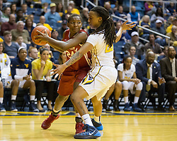 Oklahoma Sooners guard Sharane Campbell (24) attempts to drive past West Virginia Mountaineers guard Breana McDonald (20) during the second half at the WVU Coliseum.