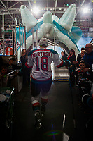 KELOWNA, CANADA - DECEMBER 27: Carsen Twarynski #18 of the Kelowna Rockets fist bumps fans as he walks through the tunnel to enter the ice against the Kamloops Blazers on December 27, 2017 at Prospera Place in Kelowna, British Columbia, Canada.  (Photo by Marissa Baecker/Shoot the Breeze)  *** Local Caption ***