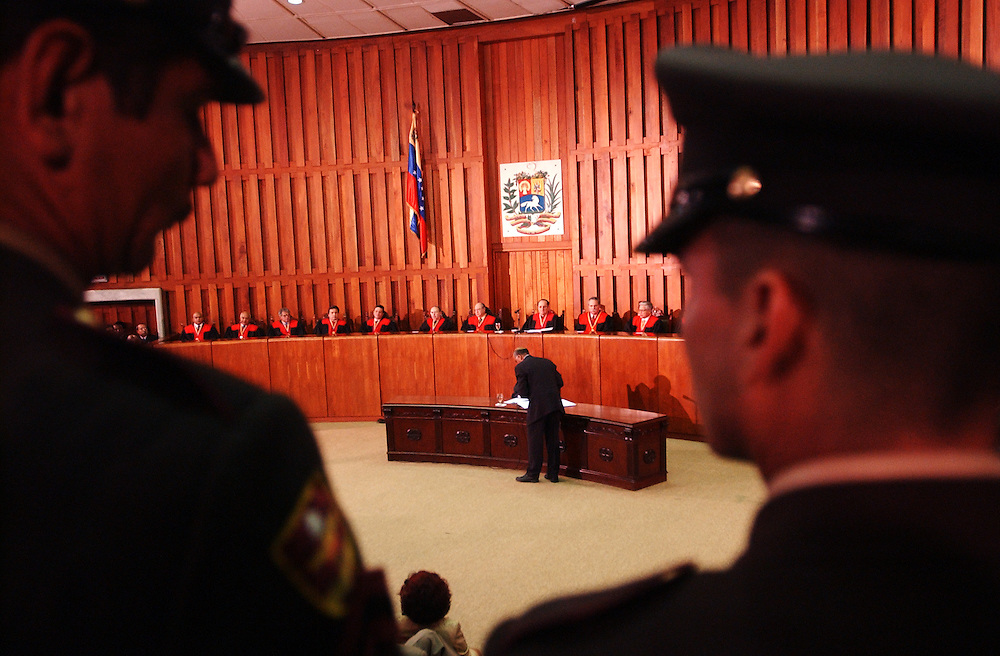 Members of the Venezuelan military stand guard as an alternate is sworn in during a ceremony of the new National Electoral Council.  The council was named by the court late Monday night after the National Assembly was unable to come to a consenus after months of debate.  The new council will be responsible for approving all steps on the road to a presidential recall referendum.