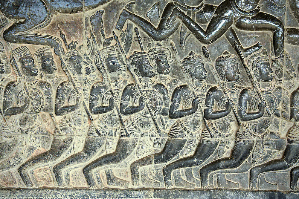 Angkor Wat: wal reliefs; Battle of Kurukshetra, details of charioteers, soldiers, horses, elephants.They run to the right in rhythm, holding lances and shields.