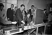 26/09/1962<br /> 09/26/1962<br /> 26 September 1962<br /> Opening of Earl Bottlers Ltd. at South Earl Street, Dublin. Minister for Justice Charles Haughey opened the new premises that produced Sandyman port. Mr Haughey inspecting machinery.