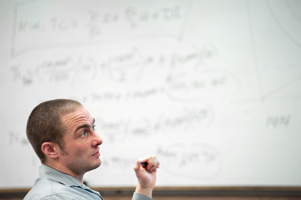 Dustin Saunlin listens during  a classroom session for an online MBA class. Photo by: Ross Brinkerhoff.