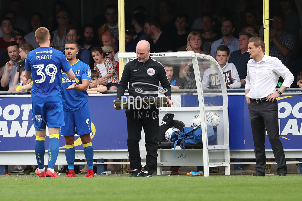 AFC Wimbledon striker Kweshi Appiah (9) coming on as sub for AFC Wimbledon striker Joe Pigott (39) during the EFL Sky Bet League 1 match between AFC Wimbledon and Oldham Athletic at the Cherry Red Records Stadium, Kingston, England on 21 April 2018. Picture by Matthew Redman.